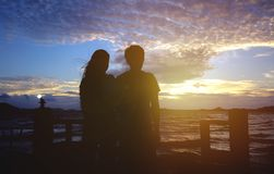 Couple lover happy silhouette in sea. Couple lover happy silhouette sea beach Royalty Free Stock Photo