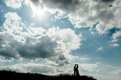 Couple lover holiday happy silhouette sky sunset. Clouds Stock Image