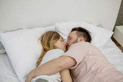 Couple lovers in the bed Stock Photos