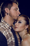 Couple of lovers. Cost profile. The girl clings to a guy Royalty Free Stock Images