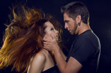 Couple of lovers. Cost profile. The guy holding the girl's face Stock Photos