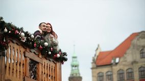 Couple of Lovers Are Cuddling With Yourself. They Are Standing On Wooden Balcony During Christmas Time. Happy New Year. Concept. HD, Good Mood, Love, Happy stock footage