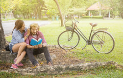 Couple of lovers doing the activities together while relaxing in a public park Royalty Free Stock Photography