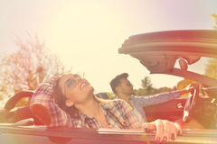 Couple of lovers driving on a convertible car - Newlywed pair on a romantic date Stock Images