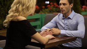 Couple of lovers emotionally discussing their relationship in street cafe, date. Stock footage stock video