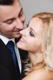 Couple of lovers groom and bride studio shot Stock Photo
