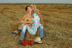 Couple of lovers in the hay with guitar Royalty Free Stock Photos