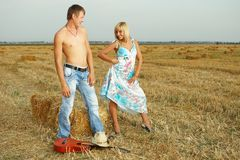 Couple of lovers in the hay with guitar Royalty Free Stock Photo