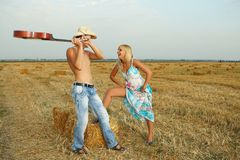 Couple of lovers in the hay with guitar Royalty Free Stock Photography