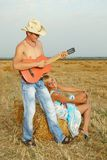 Couple of lovers in the hay with guitar Stock Image