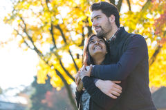 Couple of lovers hugging at autumn tree Royalty Free Stock Photo