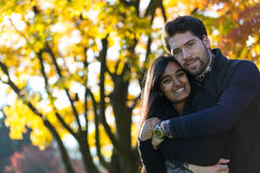 Couple of lovers hugging at autumn tree Stock Image