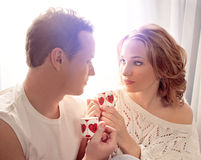 Couple of lovers. Man presents flower Stock Images