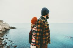 Couple lovers Man and Woman standing backs together Love and Travel. Happy emotions Lifestyle concept. Young family traveling romantic vacations autumn winter Royalty Free Stock Images
