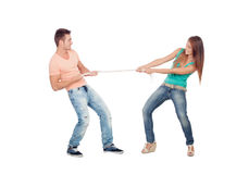 Couple of lovers pulling a rope. Isolated on a white background Royalty Free Stock Image