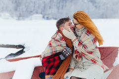 Couple Lovers Sensitive Stroking Cheek Sitting Boat Snowfall Winter Christmas Wrapped Plaid. Couple Lovers Sensitive Stroking Cheek Sitting Boat Snowfall Winter Stock Photography