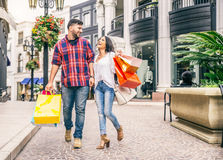 Couple of lovers shopping outdoors Royalty Free Stock Photo