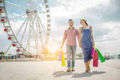 Couple of lovers shopping outdoors Royalty Free Stock Images