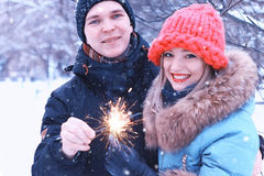 Couple lovers with sparklers happiness Stock Photos