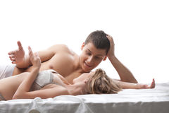 Couple lovers talk and smile in bed Royalty Free Stock Images