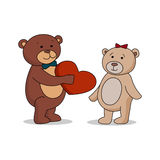 Couple lovers of teddy bears with heart in hands. Bear gives a red heart female bears.  Royalty Free Stock Image