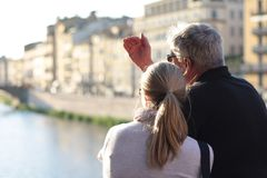 Couple watching Florence from Ponte Vecchio, Italy. royalty free stock photo