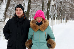 Couple of lovers walk in winter park Stock Photos