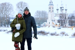 Couple of lovers walk in winter park Royalty Free Stock Photo