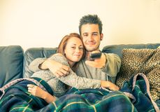 Couple of lovers watching tv stock photos