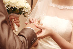 Couple of lovers who are just married with bouquet Royalty Free Stock Images