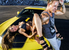 Couple of lovers and yellow sport car Royalty Free Stock Photography
