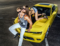 Couple of lovers and yellow sport car Royalty Free Stock Photos