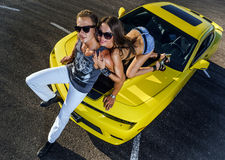 Couple of lovers and yellow sport car Stock Photos