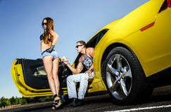 Couple of lovers and yellow sport car Stock Photo