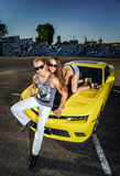 Couple of lovers and yellow sport car Stock Image