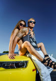 Couple of lovers and yellow sport car Royalty Free Stock Photo