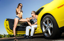 Couple of lovers and yellow sport car Royalty Free Stock Images