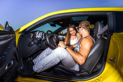 Couple of lovers and yellow sport car Stock Images