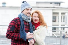 Couple loves coffee take away. Date with coffee on street. Man holding cup with hot coffee for lady. Sensual couple with coffee. stock images