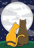 Couple of loving cats. Two loving cats sit and admire the full moon Stock Photo