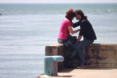 Couple loving, outdoor (sea at the port) Royalty Free Stock Image