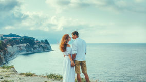 Couple Of Loving People, Young Man And Woman Standing On The Beach And Young Young Man And Woman Standing By The Sea And Kissing, Royalty Free Stock Image