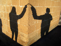 Couple loving shadow. Couple's loving shadow on the wall during sunset Stock Image