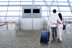 Couple with luggage in airport Royalty Free Stock Photo
