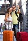 Couple with luggage doing selfie Royalty Free Stock Image
