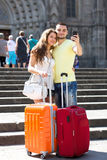 Couple with luggage doing selfie Stock Photography
