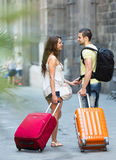 Couple  with luggage in hand Stock Photography