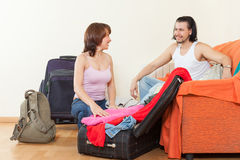 Couple with luggage in home going on holiday Stock Photography
