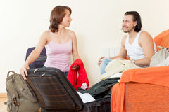 Couple with luggage in the house is going to leave a dizzying Royalty Free Stock Photo