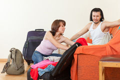 Couple with luggage looking clothes Stock Image